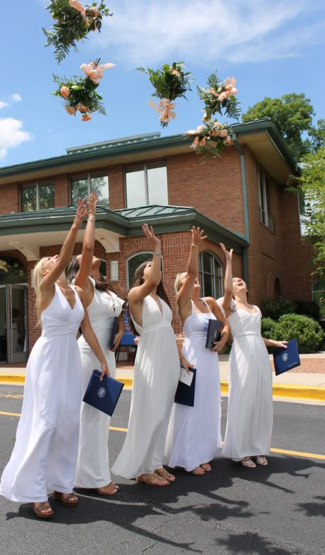 girls tossing flowers at
