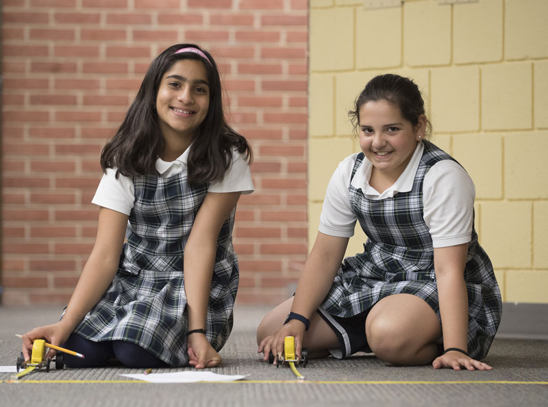 lower school design tech student race cars in the gathering area