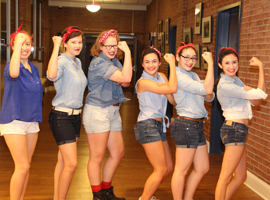 Upper School girls dressed as Rosie the Riveter